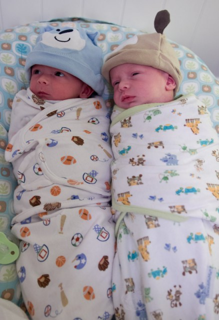 baby boys max and sam, twin brothers, wearing Summer SwaddleMe blankets