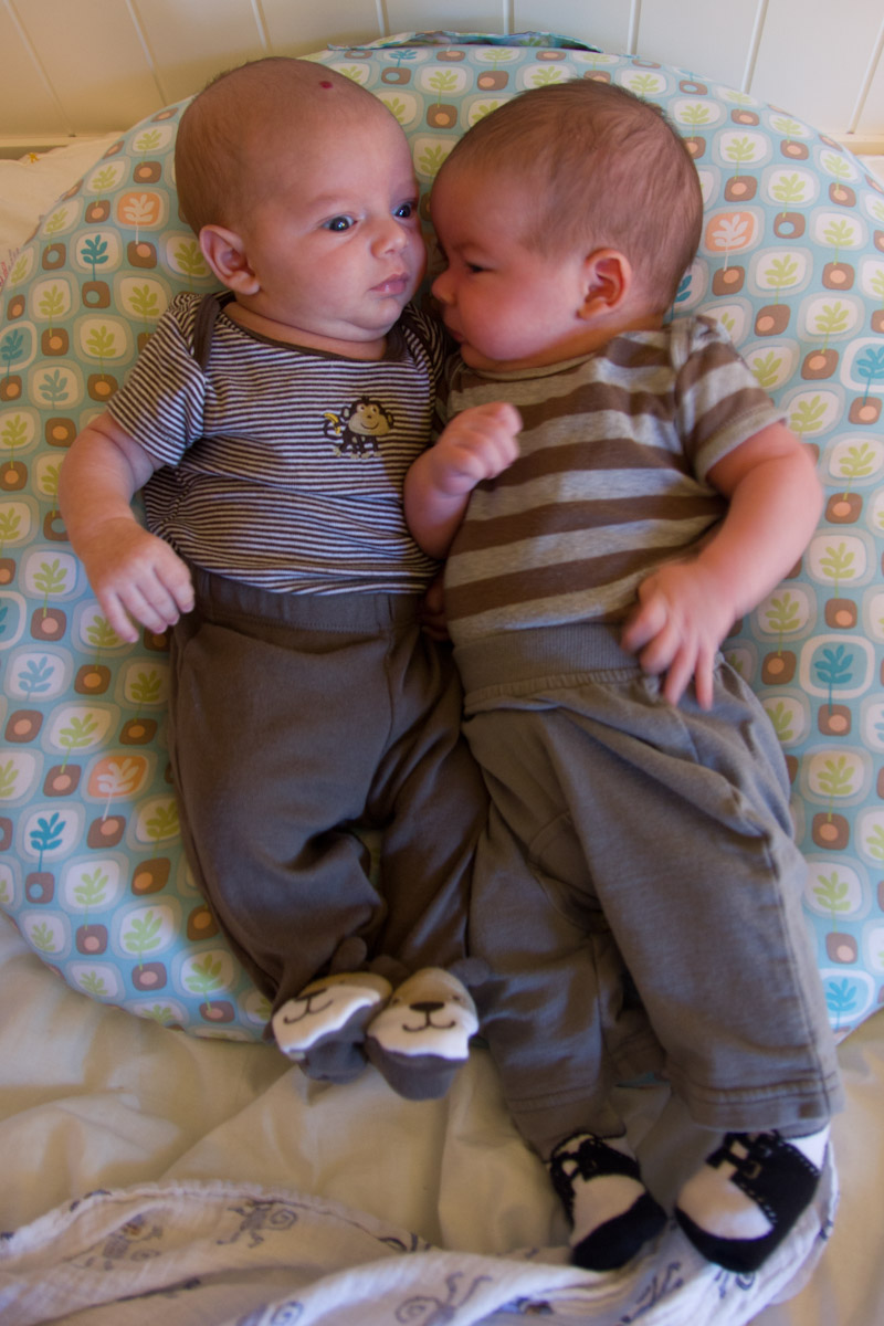 baby twin boys sam and max together on a Boppy Newborn Lounger
