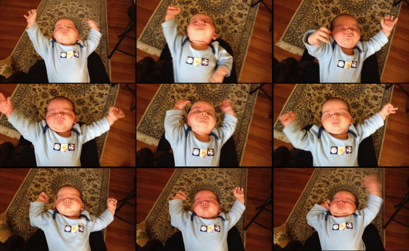 baby boy Maxwell waves his arms around like a symphony conductor