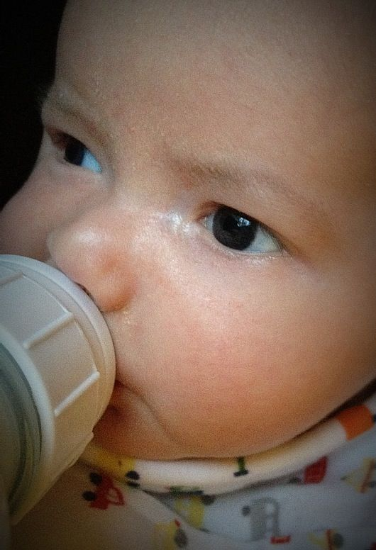 close-up of baby boy Max drinking from a bottle