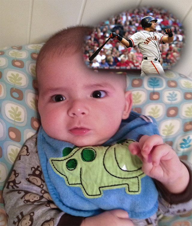 baby boy max wearing a dinosaur bib, sitting on a Boppy Newborn Lounger, reflects on Giants' Opening Day 2012 with a home run by Melky Cabrera