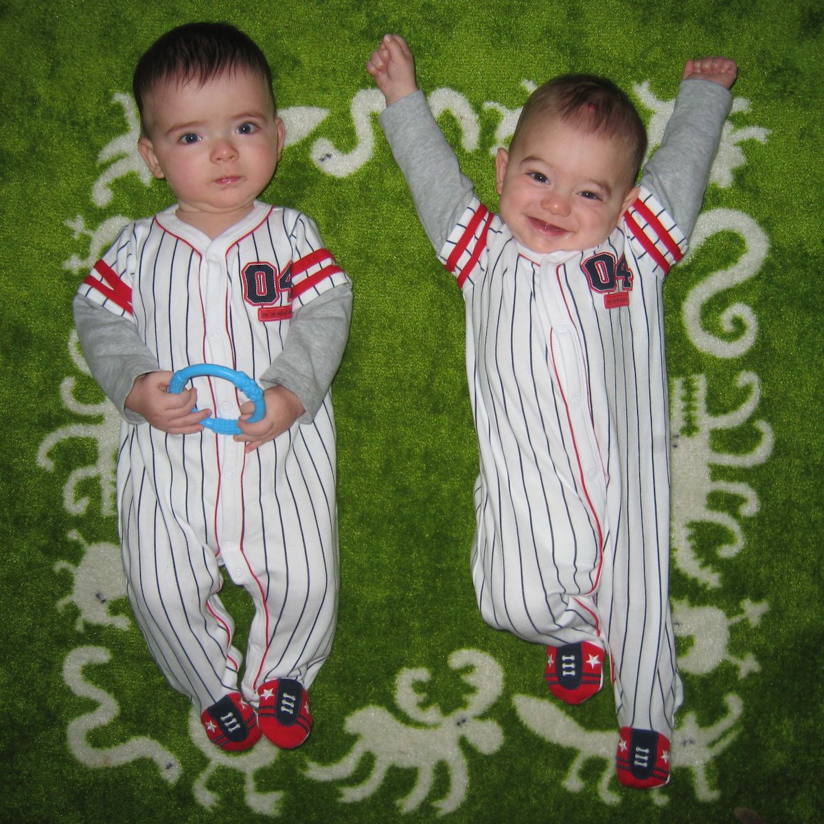 Twin baby boys of summer, Max and Sam, don pinstripes.