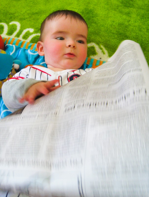 baby boy max reads the San Francisco Chronicle Newspaper