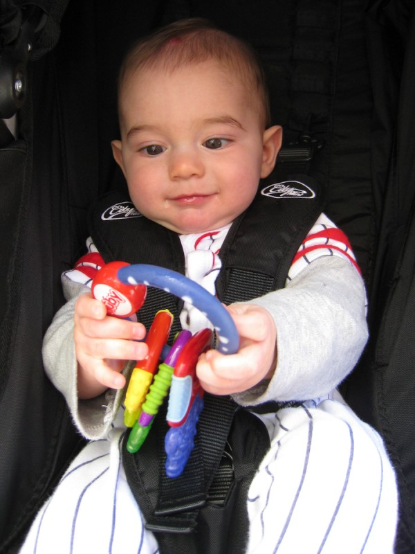 baby boy sam holds onto a keyring with three colorful keys